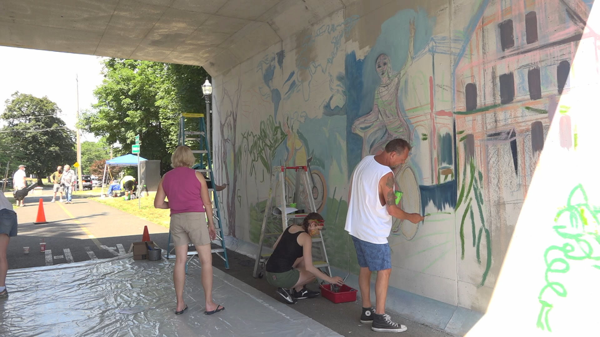 "WATCH: Join Art Works Westfield for a look at their freshly painted ""Heroes are Everywhere"" mural painted on a Columbia Greenway bike trail underpass."