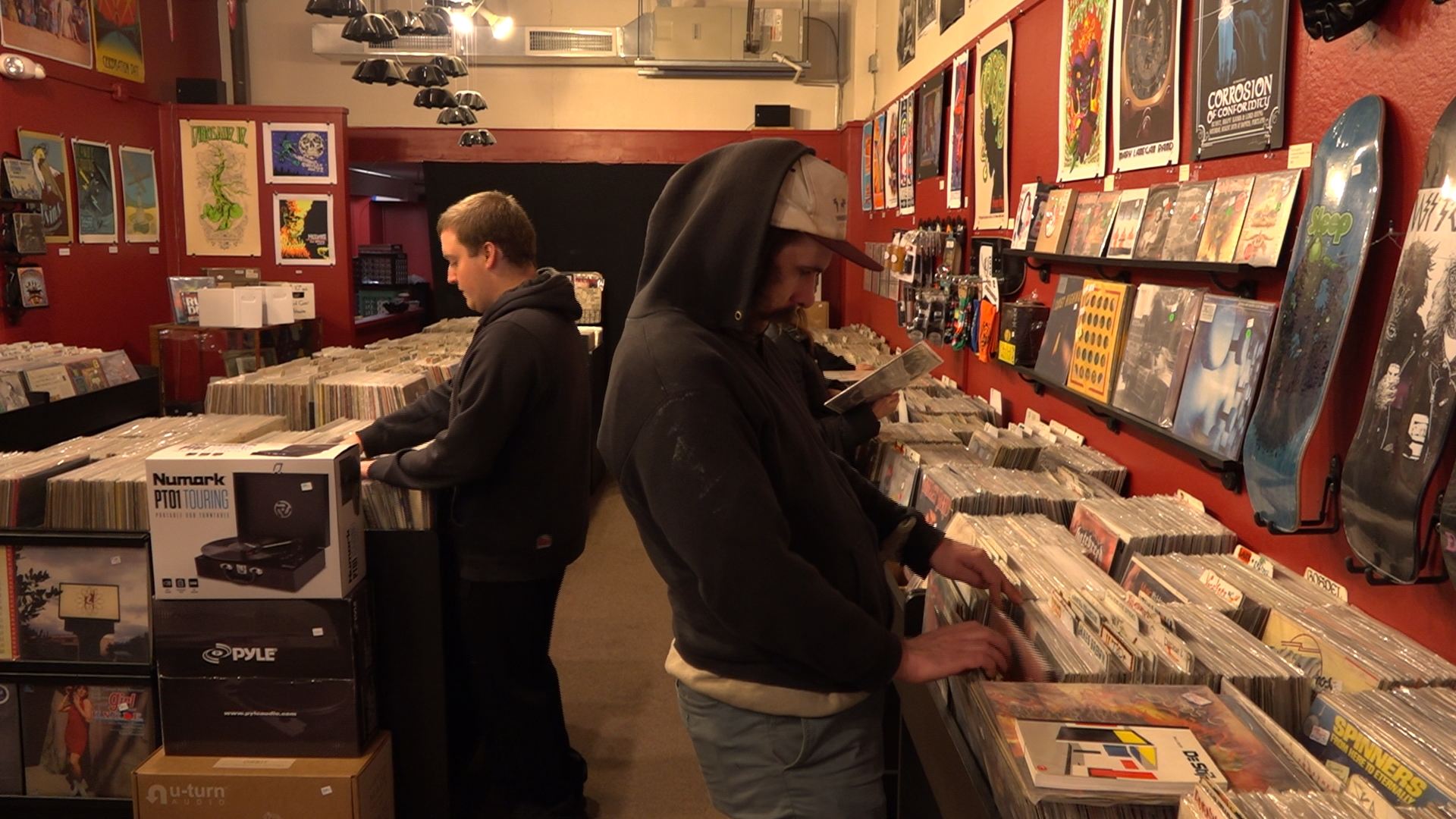 Visit Brattleboro, VT's In the Moment Records, to find out why playing music on old school vinyl records is surviving and thriving in the digital media age.